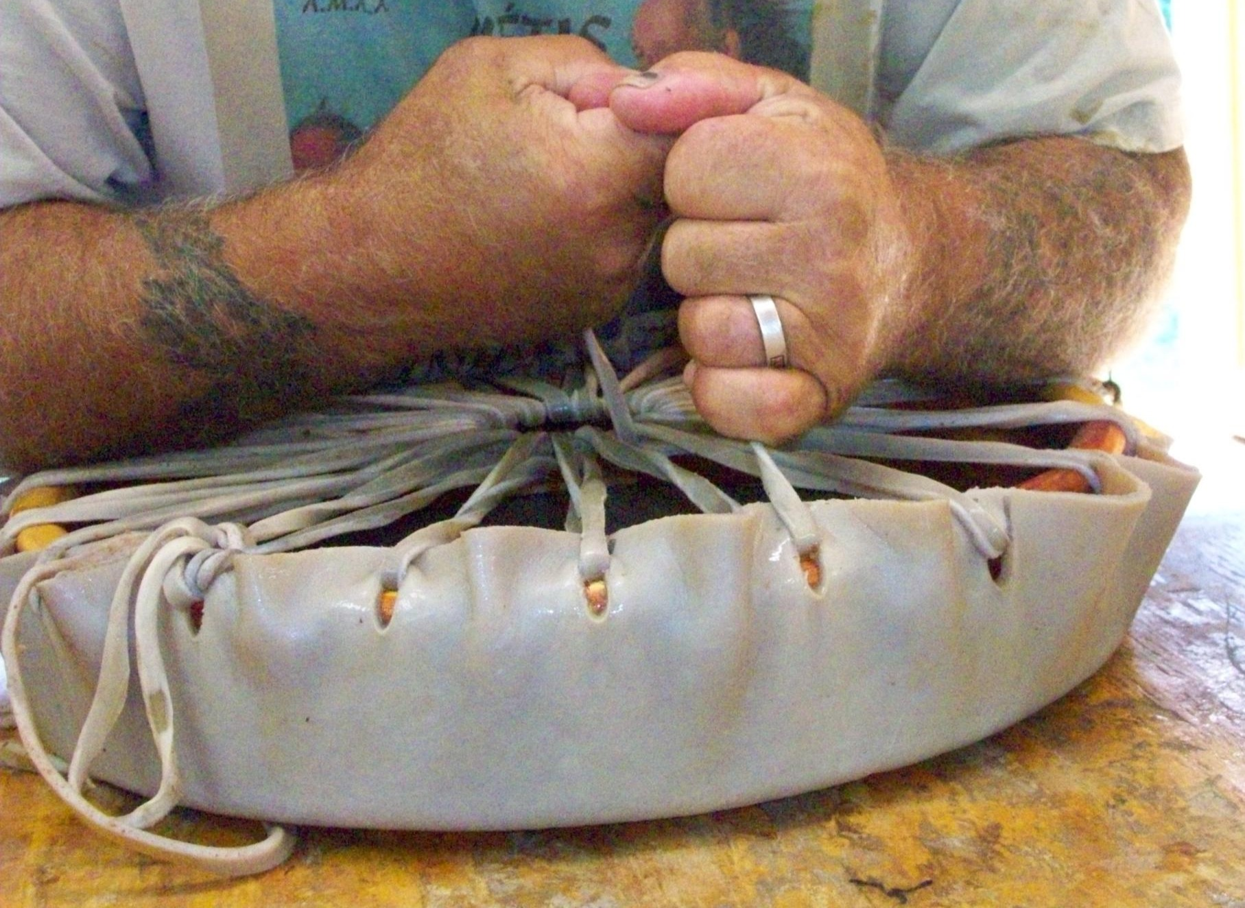 Keith Little Badger tightens Rawhide Heads on Native American Hand Drums